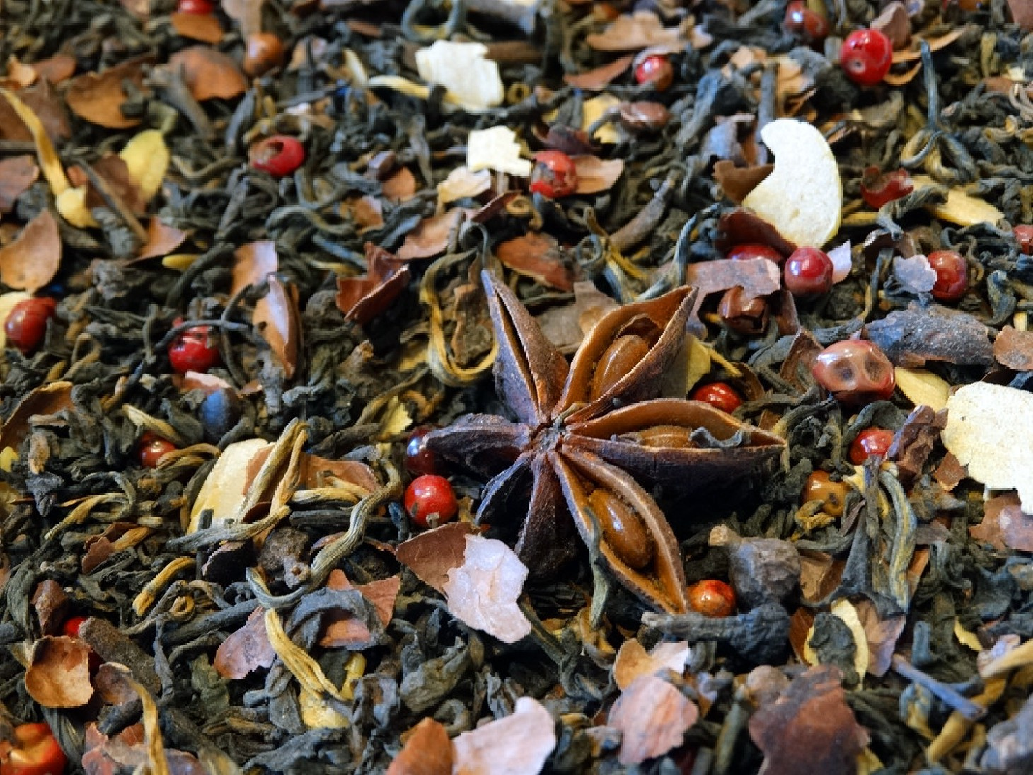 Pu er tea, cocoa beans, badians, berries and cinnamon